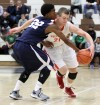 Crown Point's Thomas Bardeson drives around Michigan City's A'Seante Clark on Thursday night.
