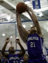Merrillville's Myranda Harris pulls down a rebound over Lake Central's Lindsay Kusbel on Friday.