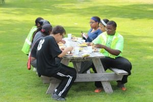 Picnic in the park held for youth workers while campers celebrate