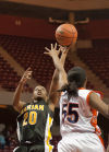 Marian Catholic's Dajhae Mullins shoots while Whitney Young's Tanita Allen defends Friday's IHSA Class 4A state semifinals.