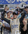 Brad Keselowski edges Junior on last lap in Las Vegas