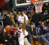 West Side junior Jeffrey Townsend shoots against E.C. Central junior Devonte Jones