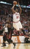 Bulls small forward Jimmy Butler shoots over Miami's Norris Cole during the second half of Game 3 