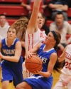 Lake Central's Gina Rubino drives to the basket against Crown Point's Katie Pawlowski