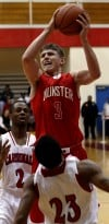 Munster's Mike Schlotman shoots over E.C. Central's Anthony Sells