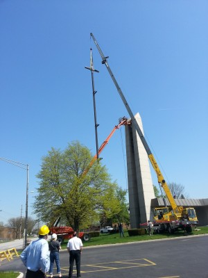 New St. Thomas More cross placed on bell tower