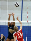 Lake Central's Alyssa Stepney goes up for a block against Crown Point's Jessica Yukich