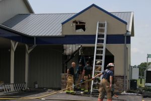 Workers using torch to kill weeds set Winfield hardware store ablaze