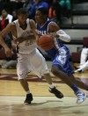 Hamilton Southeastern's Zak Irvin tries to get past Bowman Academy's Linden Jackson on Friday.