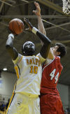 Valpo's Mussa Gueye shoots inside against UIC's Will Simonton on Tuesday night in the Horizon League Tournament.