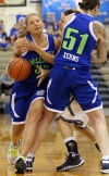 Lady McLegends guard Jenny DeMuth drives past the High School Girls All-Stars' Trina Coleman in the McLegends XII game at Highland High School on Friday.