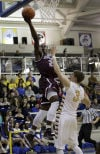 Bowman Academy guard Davon Dillard, left, shoots over Carmel's Ryan Cline on Saturday night.
