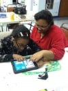 Students use iPads to learn and communicate