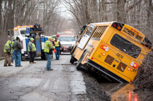 Bus leaves road, comes to rest in ditch
