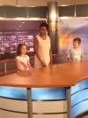 Dr. Victoria Washington with Young Helpers Jules Rush, 7 and Jimmy Rush, 9, Behind the News Desk at Lakeshore Public Television in Merrillville