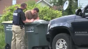 Law enforcement execute search warrant at gunman's home