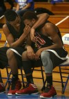 21st Century's Davis Jarnigan wipes a tear from teammate Dantrell Hurt's face