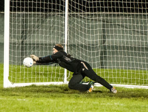 Valparaiso keeper Madison Ochs blocks a penalty kick by Munster's Saveda Majority