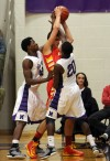 Merrillville's Jelani Pruitt, left and B.J. Jenkins defend