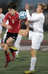 Portage's Joshua Gonzalez and Hobart's Matthew Plesac fight for possession of the ball