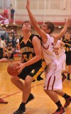 Kouts' Austin McNeil looks to score in the paint in the first quarter Friday night against Hebron.