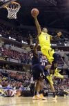 No. 8 Michigan overcomes rally by Illinois 64-63