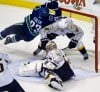 Higgins, Luongo lead Canucks over Predators