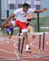 Portage's DeAndre Jackson jumps over a hurdle