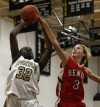 Marian's Amber Williams shoots over