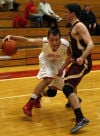 Munster's Adam Ostoich tries to drive around Chesterton's Cole Teal during Tuesday's game.