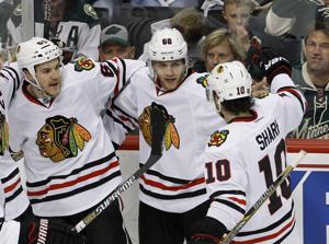 Kane, Crawford help Hawks hang on