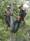 NIPSCO linemen work on power lines in St. John along Hilltop Drive