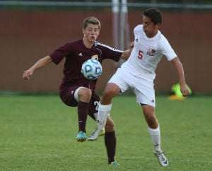 Trojans snap Crown Point's 27-match boys soccer unbeaten streak