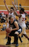 Bishop Noll's Tori Keilman drive against E.C. Central's Tiajaney Hawkins