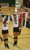 Valparaiso's Anne Clark and Danielle Suiter attempt to block Crown Point's Alaina Chacon