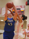 Lake Central's Lindsay Kusbel is stopped at the basket by Crown Point's Lily Wisniewski