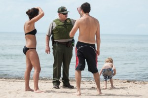 State narrows in on substance that closed beaches