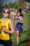 Thornton Township's Karina Perez sprints to the finish line at the Jimmy Daniels Invitational on Saturday.