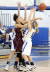 Chesterton's Kayla Malackowski is double-teamed by Lake Central's Racheal Bell, left, and Tara Zlotkowski