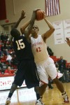 Crown Point's Jared Smoot is blocked by Michigan City's Lawrence Davis