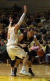 Purdue Calumet's Jaime Burkhard tries to find a way around Valparaiso's Bobby Capobianco 