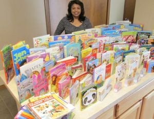 Church members donate children's books to St. Monica Home