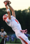 Crown Point's Morgan Kral hauls in a first-down reception