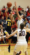 Kouts' Jayla Crump drives past South Central's Riley Popplewell during Saturday's PCC tourney championship.