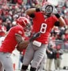 Big Ten football race ends in three-way tie