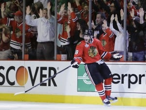 Hawks a win away from Cup as Kane scores twice to beat Bruins
