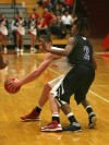 Hammond's Keirahn Richard guards Munster's Mike Schlotman