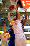 Valparaiso University's Bobby Capobianco pulls down a rebound against Saint Louis on Saturday.