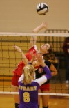 Crown Point's Courtney Kvachkoff spikes against Hobart's Caylie Puritt