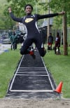 Elijah Douglas of Crete-Monee competes in the long jump during Wednesday's Southland Athletic Conference track meet.